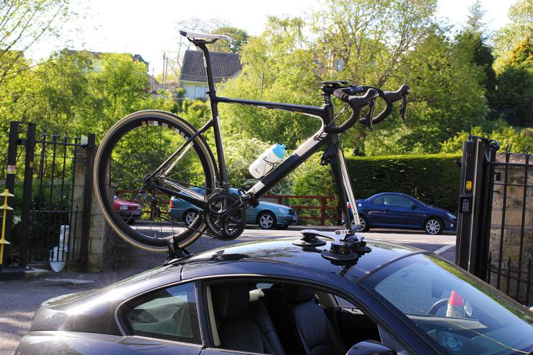 On Top Of The Car. Bike Strapped To Car